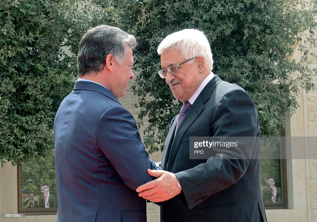 In this handout image provided by the Palestinian Presidents Office (PPO), Palestinian President Mahmoud Abbas arrives to meet his Majesty King Abdullah II to sign an agreement to defend Jerusalem and it's Islamic and Christian holy sites on March 31, 2013 at The Royal Palace on March 31, 2013 in Amman, Jordan.
