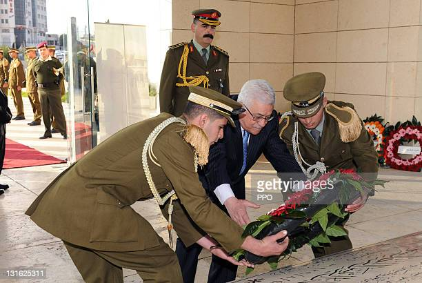 In this handout image provided by the Palestinian Press Office Palestinian President Mahmoud Abbas lays a wreath on the grave of late President...