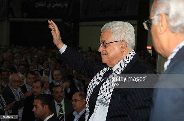 In this handout image provided by the Palestinian Press Office Palestinian President and Fatah leader Mahmoud Abbas waves to party members during the...