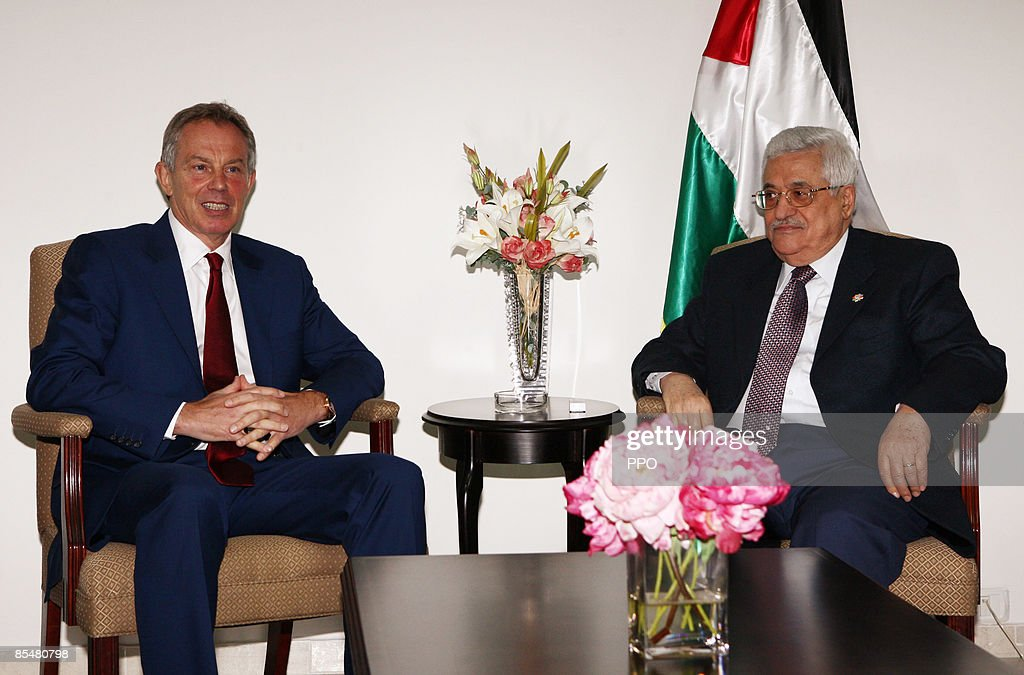 In this handout image provided by the Palestinian Press Office, Mr Palestinian President, Mahmoud Abbas (R) attends a meeting with Middle East Quartet envoy Tony Blair on March 18, 2009 in Ramallah, West Bank.