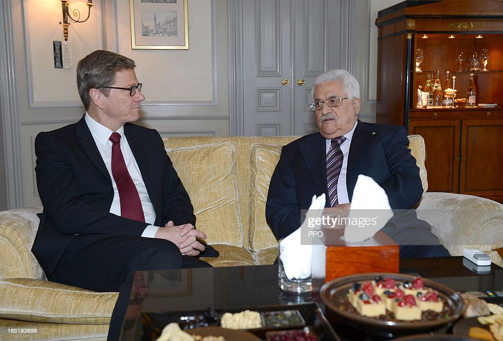 In this handout image provided by the Palestinian Press Office (PPO), President of the Palestinian National Authority Mahmoud Abbas (R) and German Foreign Minister Guido Westerwelle (FDP) meet for a bilateral talk on October 18, 2013 in Hotel Adlon in Berlin, Germany. Abbas is currently in Europe partly to lobby the European Union against providing Israel funds for housing expansion in occupied territories.
