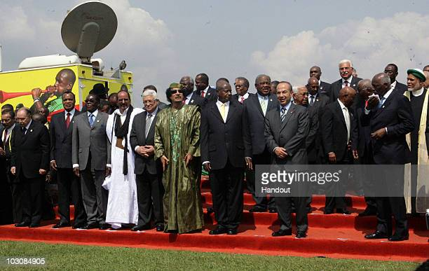 In this handout image provided by the Palestinian Press Office Palestinian President Mahmoud Abbas poses with Mohamed Abdelaziz Uganda President...