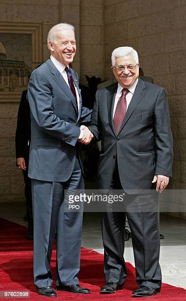 In this handout image provided by the Palestinian Press Office US Vice President Joe Biden and Palestinian President Mahmoud Abbas shake hands prior...