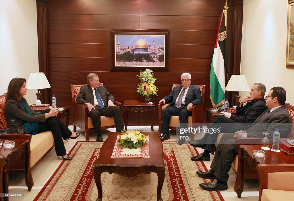 In this handout image provided by the PPO, Palestinian President, Mahmoud Abbas (R, center) meets with Robert Serry (L, center), the Dutch diplomat who currently serves as UN special coordinator for the Middle East peace process June 29, 2012 in Ramallah, West Bank.