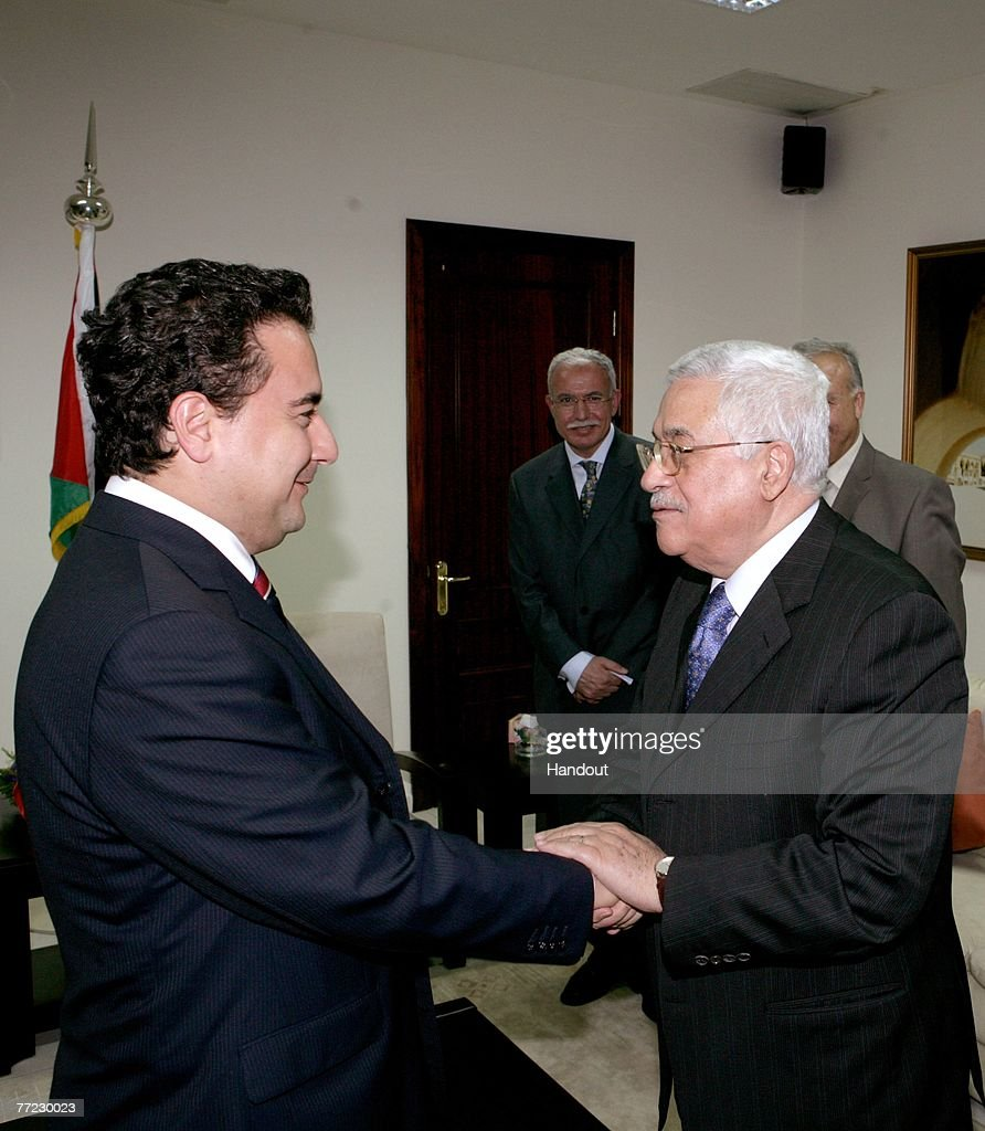 In this handout image provided by the PPO (Palestinian Press Office), Palestinian President Mahmoud Abbas (R) greets Turkish Foreign Minister Ali Babajanat his office on October 8, 2007 in Ramallah, West Bank. Turkey have recently been in discussion with Syria to agree that they will not allow Israel to use its airspace to strike Syria.