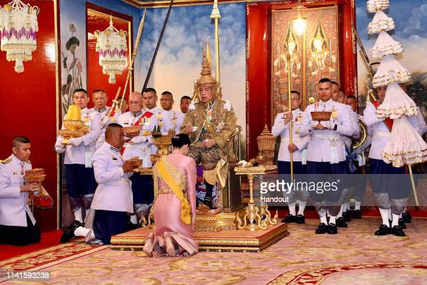 In this handout image provided by the Public Relations for the Coronation of King Rama X Thai King Maha Vajiralongkorn and his wife Queen Suthida...
