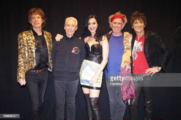 In this handout image provided by The Rolling Stones Mick Jagger Charlie Watts Katy Perry Keith Richards and Ronnie Wood pose backstage at the MGM...