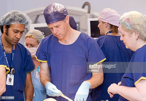 In this handout image provided by The Royal Children's Hospital Melbourne surgeon Andrew Greensmith and team work on the separation of twins Krishna...