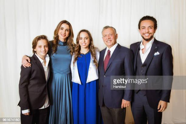 In this handout image provided by the Royal Hashemite Court Jordan's King Abdullah II his wife Queen Rania and Crown Prince Al Hussein and Prince...