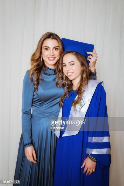 In this handout image provided by the Royal Hashemite Court, Queen Rania of Jordan , during the graduation ceremony of Princess Salma from the...