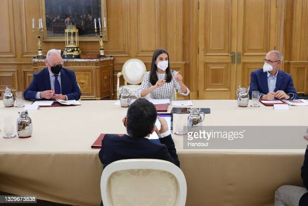 In this handout image provided by the Royal Household, Queen Letizia of Spain attends a meetign on the impact mental health during the pandemic at...