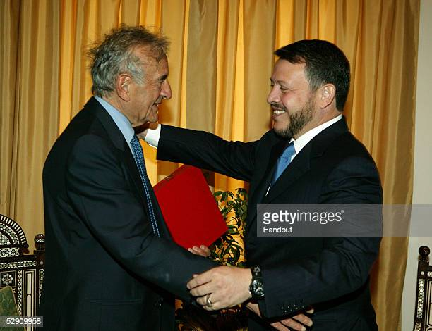 In this handout image provided by the Royal Jordanian Palace Jordan's King Abdullah congratulates Nobel Peace Prize winner and Holocaust survivor...