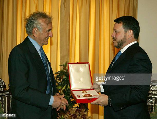 In this handout image provided by the Royal Jordanian Palace Jordan's King Abdullah presents Nobel Peace Prize winner and Holocaust survivor Elie...
