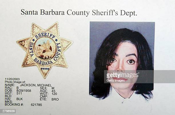 In this handout image provided by the Santa Barbara County Sheriff's Office singer Michael Jackson is shown in a mug shot after he was booked on...