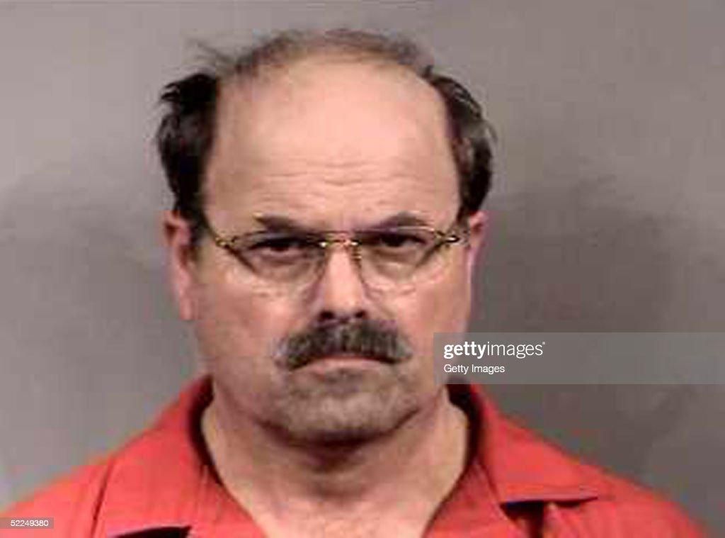 In this handout image provided by the Sedgwick County Sheriff's office, BTK murder suspect Dennis Rader stands for a mug shot released February 27, 2005 in Sedgwick County, Kansas. Rader is the suspect whom police have arrested on suspicion of first-degree murder in connection with the 10 deaths now tied to the serial killer known as BTK.