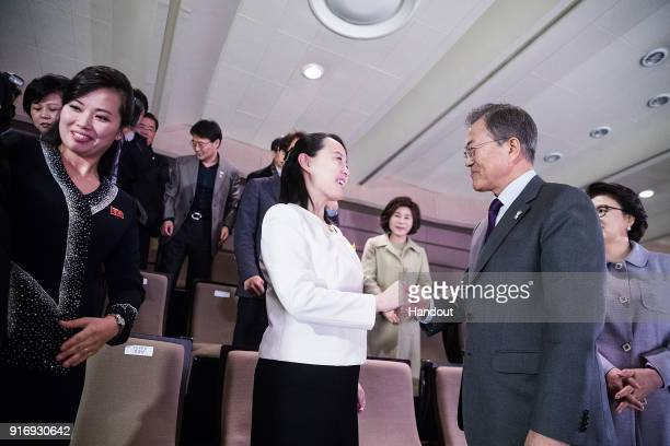 In this handout image provided by the South Korean Presidential Blue House South Korean President Moon Jaein shakes hands with Kim YoJong North...