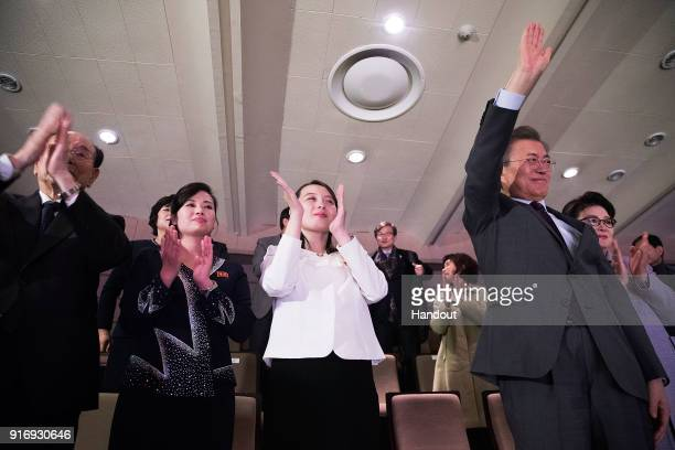 In this handout image provided by the South Korean Presidential Blue House South Korean President Moon Jaein waves with North Korea's art troupe head...