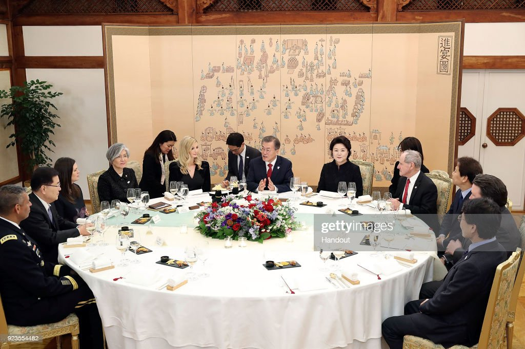 In this handout image provided by the South Korean Presidential Blue House, South Korean President Moon Jae-In (C) talks with Ivanka Trump during their dinner at the Presidential Blue House on February 23, 2018 in Seoul, South Korea. Ivanka Trump is on a four-day visit to South Korea to attend the closing ceremony of the Pyeongchang Winter Olympics and to meet South Korean President Moon.
