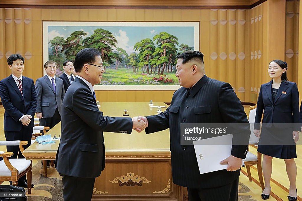 In this handout image provided by the South Korean Presidential Blue House, Chung Eui-Yong (L), head of the presidential National Security Office shakes hands with North Korean leader Kim Jong-Un (R) during their meeting on March 5, 2018 in Pyongyang, North Korea. South Korean envoys are to visit North Korea for two days to discuss issues.