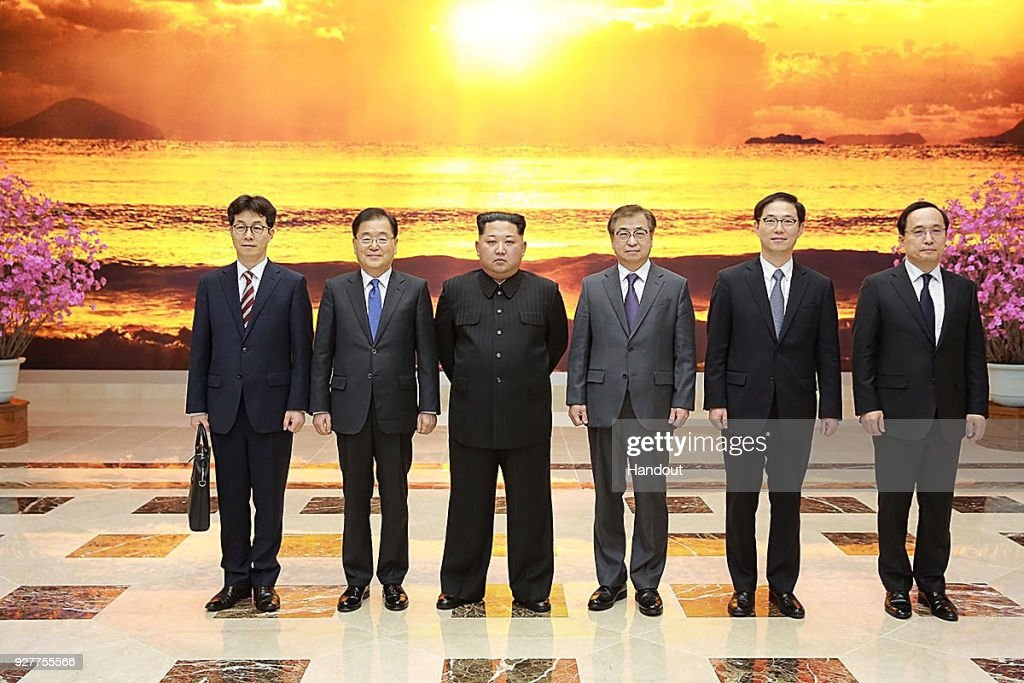 In this handout image provided by the South Korean Presidential Blue House, Chung Eui-Yong (2nd L), head of the presidential National Security Office pose with North Korean leader Kim Jong-Un (3rd L) on March 5, 2018 in Pyongyang, North Korea. South Korean envoys are to visit North Korea for two days to discuss issues.