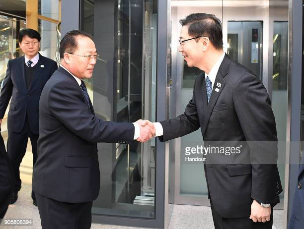 In this handout image provided by the South Korean Unification Ministry South Korean Vice Unification Minister Chun HaeSung shakes hands with the...
