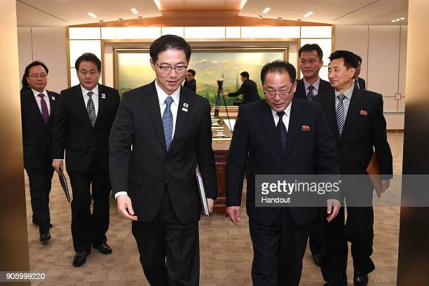 In this handout image provided by the South Korean Unification Ministry South Korean Vice Unification Minister Chun HaeSung and the head of North...