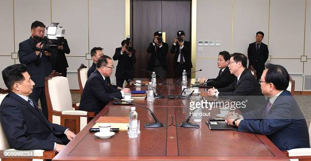 In this handout image provided by the South Korean Unification Ministry South Korean Vice Unification Minister Chun HaeSung talks with the head of...