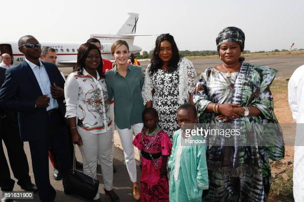 In this handout image provided by the Spanish Royal Household Queen Letizia of Spain poses with some children during her visit on December 13 2017 in...