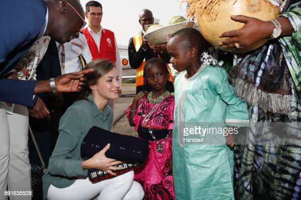 In this handout image provided by the Spanish Royal Household Queen Letizia of Spain speaks to children during her visit on December 13 2017 in...