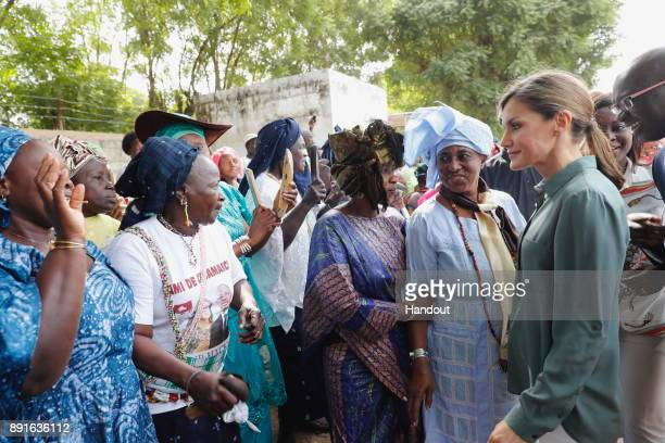 In this handout image provided by the Spanish Royal Household Queen Letizia of Spain greets people during her visit on December 13 2017 in Ziguinchor...