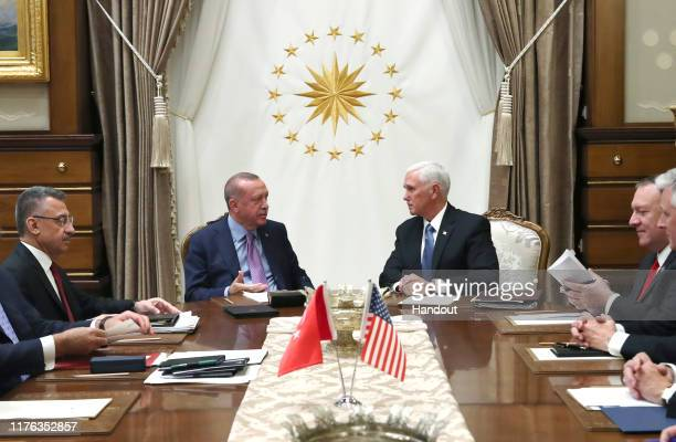 In this handout image provided by the Turkish presidency Turkish President Recep Tayyip Erdogan meets with US Vice President Mike Pence Secretary of...