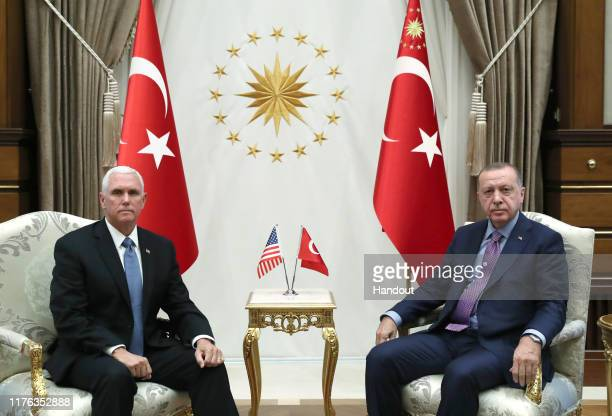 In this handout image provided by the Turkish presidency Turkish President Recep Tayyip Erdogan receives US Vice President Mike Pence at Presidential...