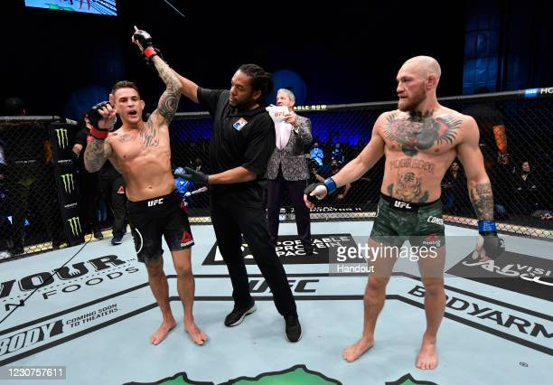 In this handout image provided by the UFC, Dustin Poirier reacts after his knockout victory over Conor McGregor of Ireland in a lightweight fight...