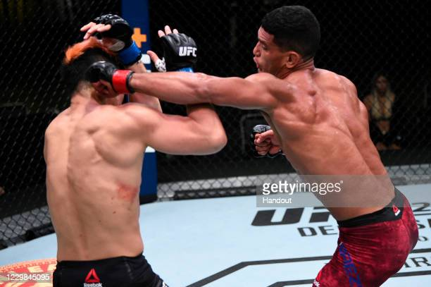 In this handout image provided by the UFC, Miguel Baeza punches Takashi Soto of Japan in their welterweight bout during the UFC Fight Night at UFC...