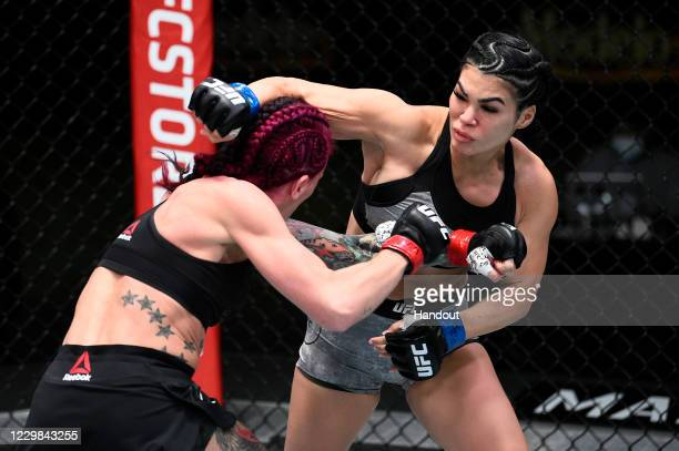 In this handout image provided by the UFC, Rachael Ostovich punches Gina Mazany in their women's flyweight bout during the UFC Fight Night at UFC...