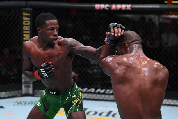 In this handout image provided by the UFC, Randy Brown of Jamaica punches Jared Gooden in their welterweight bout during the UFC Fight Night event at...