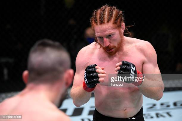 In this handout image provided by the UFC, Spike Carlyle faces Bill Algeo in their featherweight bout during the UFC Fight Night at UFC APEX on...