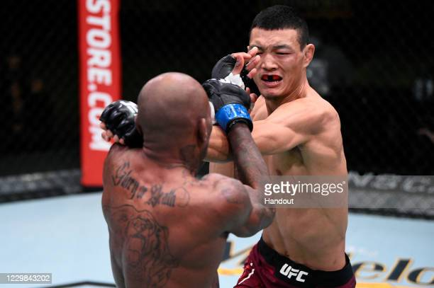 In this handout image provided by the UFC, Su Mudaerji of Tibet punches Malcolm Gordon in their flyweight bout during the UFC Fight Night at UFC APEX...
