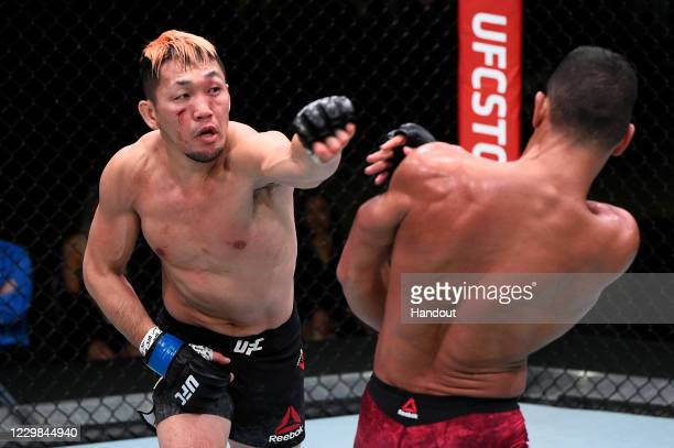 In this handout image provided by the UFC, Takashi Soto of Japan punches Miguel Baeza in their welterweight bout during the UFC Fight Night at UFC...