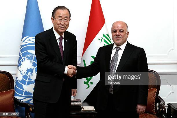 In this handout image provided by the United Nations Haider alAbadi Prime Minister of the Republic of Iraq meets SecretaryGeneral of the United...