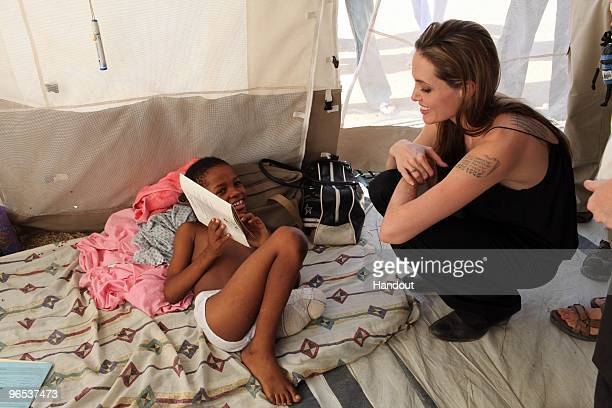 In this handout image provided by the United Nations High Commissioner for Refugees Angelina Jolie Goodwill Ambassador of the UN High Commissioner...