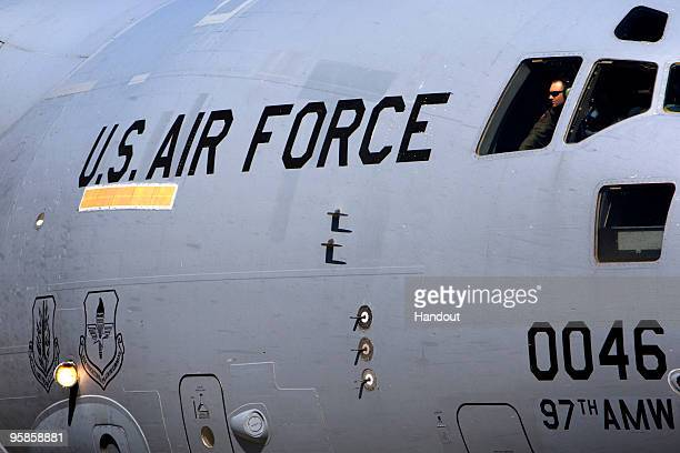 In this handout image provided by the United Nations Stabilization Mission in Haiti US Air Force plane arrives January 18 2010 in PortauPrince Haiti...