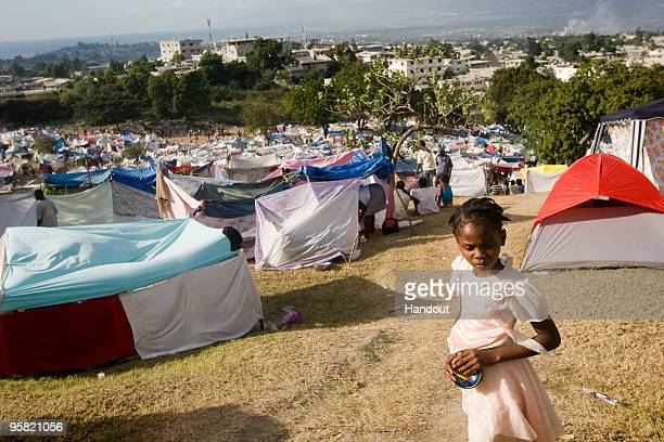 In this handout image provided by the United Nations thousands of Haitians live in makeshift camp at a golf course January 16 2010 in PortauPrince...