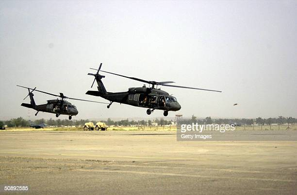 In this handout image provided by the U.S. Air Force, Blackhawk helocopters take off from the Kirkuk Region Airbase as F-16's from the 107th Fighter...
