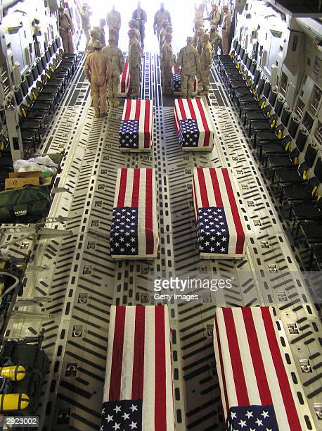 In this handout image provided by the US Air Force eight American flagdraped caskets line the floor of a C17 Globemaster III from the 15th Airlift...