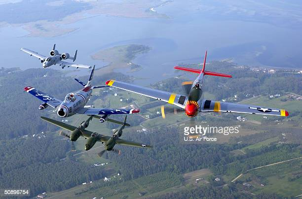 In this handout image provided by the US Air Force four generations of Air Force fighters take part in the Heritage Flight as they fly over over...