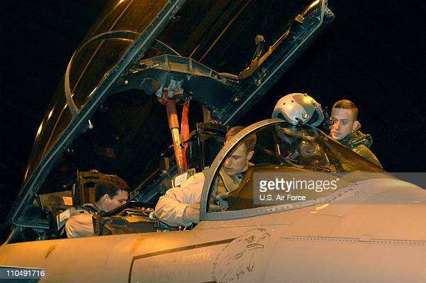 In this handout image provided by the US Air Force members of 492nd Fighter Squadron secure themselves on an F15E Strike Eagle prior to their...