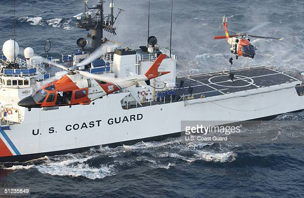 In this handout image provided by the US Coast Guard a Coast Guard maritime security force practices fastroping to the Coast Guard cutter Seneca's...