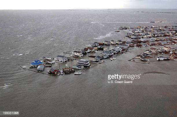 In this handout image provided by the US Coast Guard homes are flooded after Hurricane Sandy made landfall on the southern New Jersey coastline...