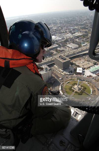In this handout image provided by the US Coast Guard Sean Kevany a detective with the New Orleans Police Department observes the crowds that have...